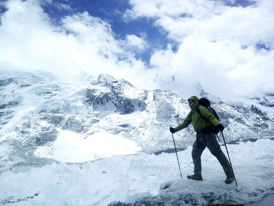 Terrill at Everest Base Camp, surrounded by glistening white snow and ice